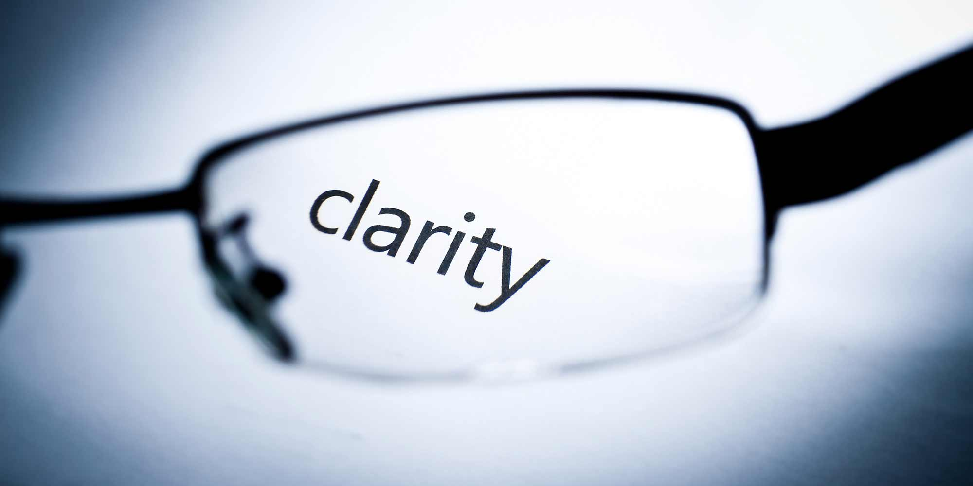 The word Clarity viewed through a spectacle lens